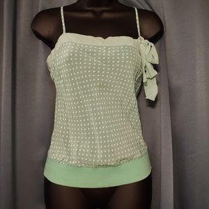 Adorable string tanktop with an off the strap bow